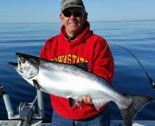 "Check out this NICE 17lb. King. Caught aboard Charter Boat ""Stellar"" on Lake Michigan with Captain Rich."