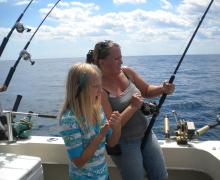 Reeling in a fish on Lake Michigan!