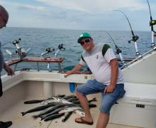 Just another GREAT day aboard a charter boat fishing on Lake Michigan!