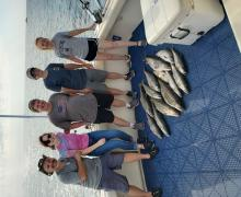 All smiles while fishing on Lake Michigan.